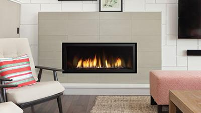 "Medium direct vent contemporary fireplace, 40"" wide with clean edge installation. Surround and media choices including stones, pebbles and driftwood logs are available."