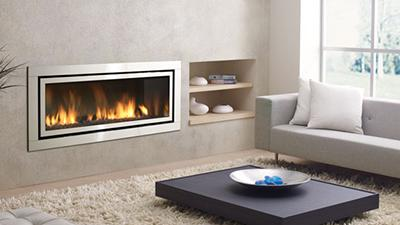 Large direct vent contemporary fireplace, clean edge and surrounds are available. Media choices including stones, pebbles and driftwood logs are available.