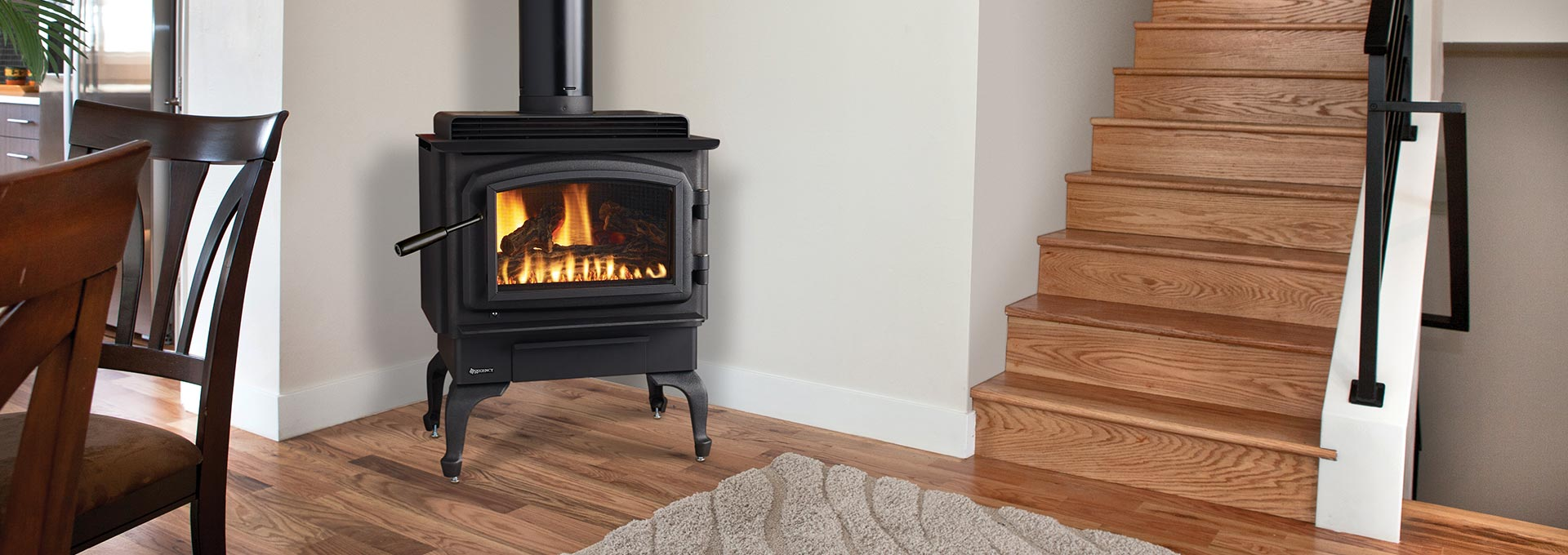 Contura rc500e freestanding gas stove shown with black cast iron legs and black door