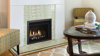 A compact gas fireplace insert that will add a contemporary look to your room. All the features you need to keep your room cozy and on-trend.
