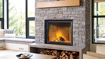 A Regency wood fireplace combines the ageless love of a natural fire with today's lifestyle and the latest technology.