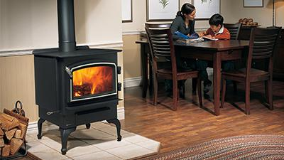 F1100 wood stove with black legs & nickel accent door