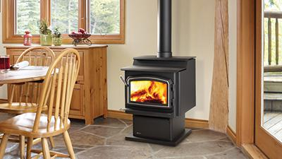 S2400 wood stove with pedestal & nickel accent door
