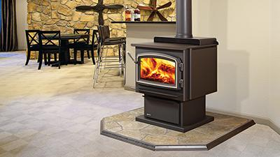 F3100 wood stove with black pedestal & black contemporary door